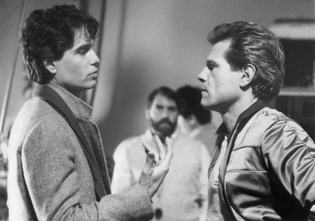 "Holland with Chris Sarandon (L.) on the set of ""Fright Night"""