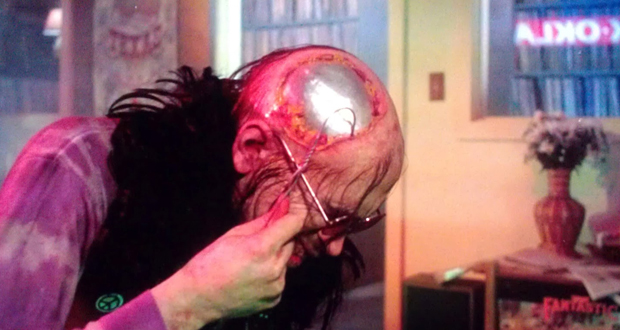 Chop Top scratches the plate in his head in Texas Chainsaw Massacre 2