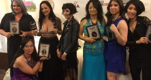 """The Twisted Twins"" Jen and Sylvia Soska presenting the ""Etheria Film Night"" ""Jury Prize"" to one lucky attending filmmaker."