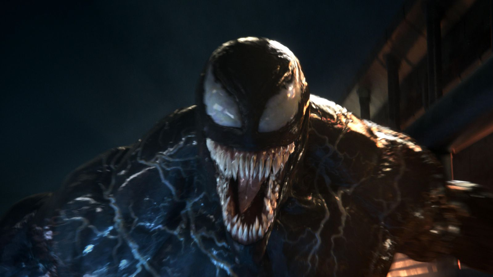 'Venom' Review: Tom Hardy Chews Through The Comic Book Formula